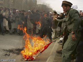 Afghan protesters burn a Danish flag